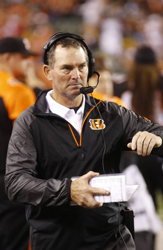 IN this Sept. 17, 2013 file photo, Cincinnati Bengals defensive coordinator Mike Zimmer watches from the sidelines in the second half of an NFL football game against the Pittsburgh Steelers, in Cincinnati. The Minnesota Vikings have chosen  Zimmer as their new head coach, according to multiple media reports. Zimmer will replace Leslie Frazier, who was fired after the team finished 5-10-1 this season