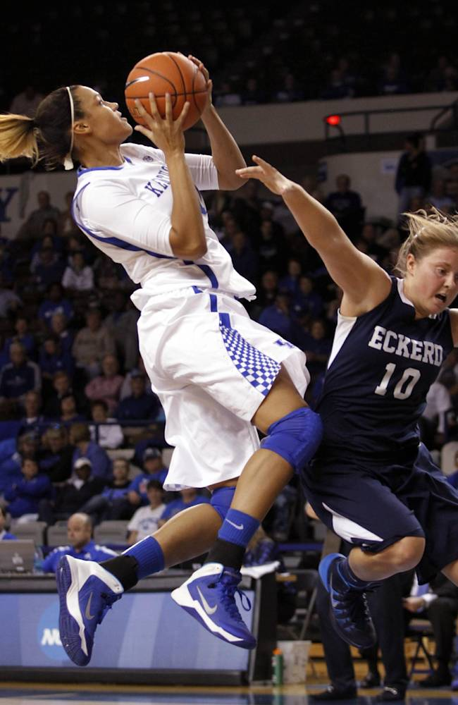Kentucky's Azia Bishop, left, shoots under pressure from Eckerd's Kayla Bowlin during the second half of an NCAA college basketball exhibition, Sunday, Nov. 3, 2013, in Lexington, Ky. Kentucky won 83-35