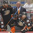 FILE - In this May 16, 2014 file photo, Anaheim Ducks right wing Teemu Selanne (8), of Finland, takes to the ice as head coach Bruce Boudreau, upper center, looks on along with center Nick Bonino during the third period in Game 7 of an NHL hockey second-round Stanley Cup playoff series against the Los Angeles Kings in Anaheim, Calif. elanne managed to make a stir on the first day of the Anaheim Ducks' training camp even after his retirement. Coach Bruce Boudreau and Selanne's former teammates reacted with disappointment and chuckles Thursday, Sept. 18, 2014, after hearing about Selanne's fierce criticism of Boudreau in a new biography published in Finland. (AP Photo/Mark J. Terrill, File)