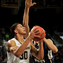 Notre Dame forward Zach Auguste puts up a shot as Mount Saint Mary's center Taylor Danaher defends in the first half of an NCAA college basketball game, Tuesday Dec. 9, 2014, in South Bend, Ind. (AP Photo/Joe Raymond)