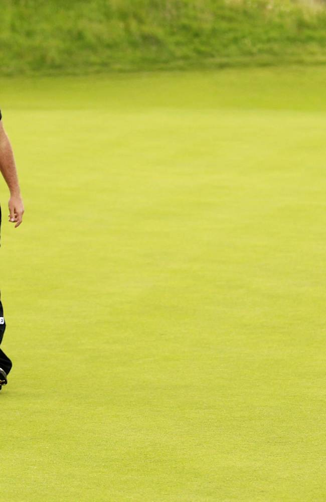 France's Edouard Dubois reacts after missing a birdie putt on the 18th green during day one of the Irish Open Golf Championship at Royal Portrush Golf Club, Portrush, Northern Ireland, Thursday, June 28, 2012