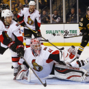 Ottawa Senators defenseman Jared Cowen (2) and goalie Robin Lehner combine to keep a shot out of the net during the second period of the Senators 3-2 shootout win over the Boston Bruins in an NHL hockey game in Boston Saturday, Dec. 13, 2014 The Associate