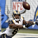 In this Nov. 23, 2014, file photo, St. Louis Rams wide receiver Kenny Britt hauls in a pass against the San Diego Chargers during the second half of an NFL football game in San Diego. Britt is the top deep threat for the Rams (6-7), averaging 18.7 yards o
