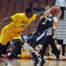 Long Beach State forward Tony Freeland (22) fouls UC Irvine forward Travis Souza (2) during the first half of a Big West tournament NCAA college basketball game in Anaheim, Calif., Friday, March 15, 2013. (AP Photo/Reed Saxon)