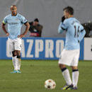 Manchester City's Vincent Kompany, left, reacts after CSKA's Bebras Natcho scored a penalty during the Champions League Group E soccer match between CSKA Moscow and Manchester City at Arena Khimki stadium in Moscow, Russia, Tuesday Oct. 21, 2014