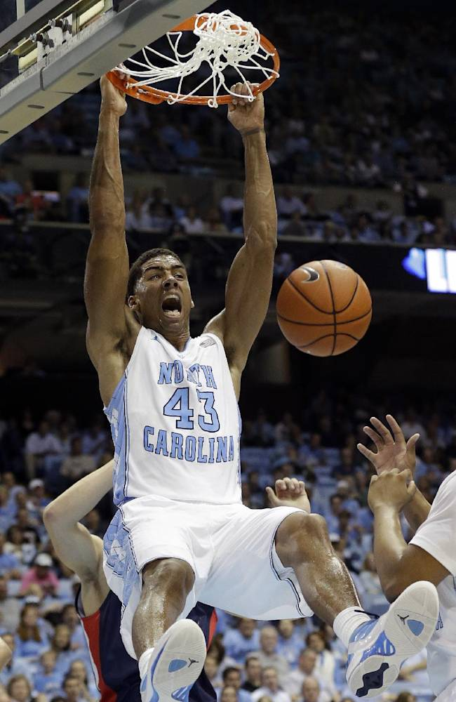 North Carolina's James Michael McAdoo (43) dunks against Belmont during the first half of an NCAA college basketball game in Chapel Hill, N.C., Sunday, Nov. 17, 2013