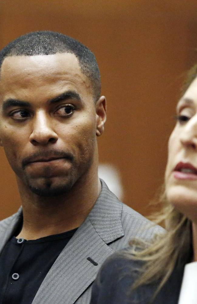 Former NFL safety Darren Sharper looks toward his attorney Blair Berk during an appearance in Los Angeles Superior Court in Los Angeles, where he pleaded not guilty Thursday, Feb. 20, 2014, to charges of drugging and raping two women. Sharper's bail has been increased from $200,000 to $1 million