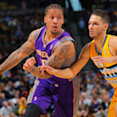 DENVER, CO - APRIL 17:  Michael Beasley #0 of the Phoenix Suns controls the ball against Evan Fournier #94 of the Denver Nuggets at the Pepsi Center on April 17, 2013 in Denver, Colorado. NOTE TO USER: User expressly acknowledges and agrees that, by downloading and or using this photograph, User is consenting to the terms and conditions of the Getty Images License Agreement.  (Photo by Doug Pensinger/Getty Images)