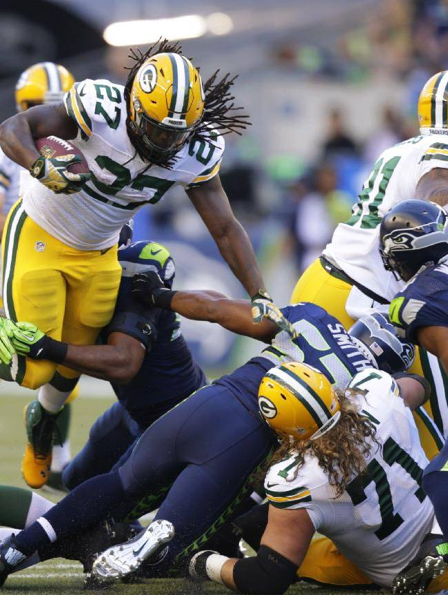 Green Bay Packers running back Eddie Lacy (27) leaps as he runs against the Seattle Seahawks in the first half of an NFL football game, Thursday, Sept. 4, 2014, in Seattle