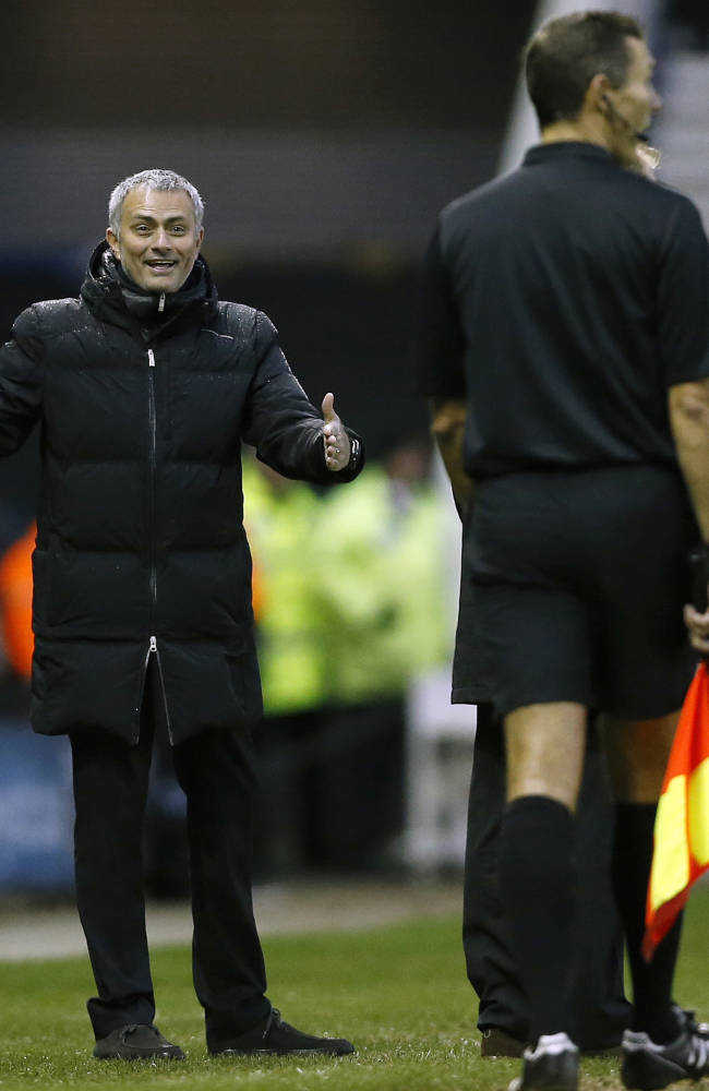 Chelsea's manager manager Jose Mourinho, left, laughs as he comments to a linesman during the English FA Cup third round soccer match between Derby County and Chelsea at the iPro Stadium in Derby, England, Sunday, Jan. 5, 2014
