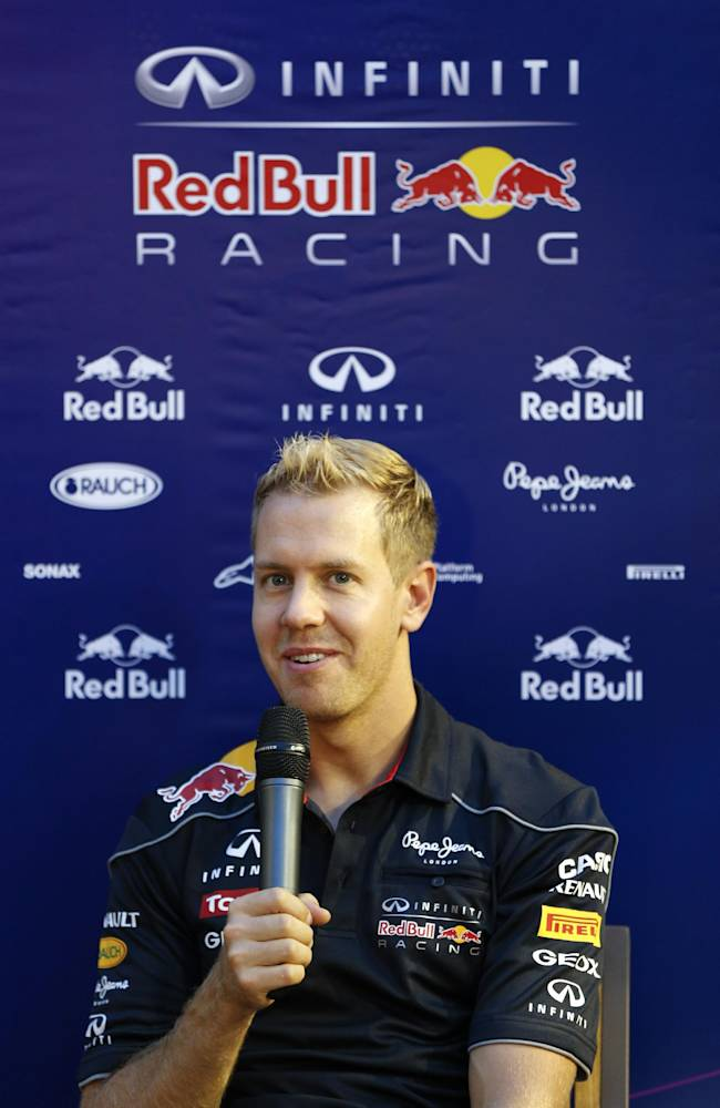 Red Bull driver Sebastian Vettel of Germany speaks during a press conference outside his team's garage ahead of Sunday's Singapore Formula One Grand Prix on the Marina Bay City Circuit, in Singapore Thursday, Sept. 19, 2013