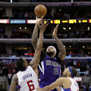 Sacramento Kings center DeMarcus Cousins, middle, misses the final shot of the game under pressure by Los Angeles Clippers' DeAndre Jordan, left, and Jared Dudley during the second half of an NBA basketball game in Los Angeles, Saturday, Nov. 23, 2013. Th