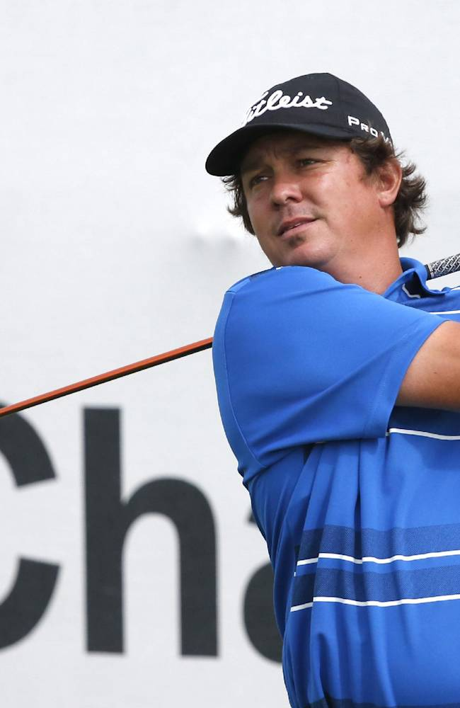 Jason Dufner watches his tee shot off the first hole during the pro-am round of the BMW Championship golf tournament at Conway Farms Golf Club in Lake Forest. Ill., Wednesday, Sept. 11, 2013