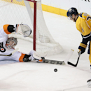 Philadelphia Flyers goalie Steve Mason reaches to block a shot by Nashville Predators forward Colin Wilson (33) in the third period of an NHL hockey game Saturday, Nov. 30, 2013, in Nashville, Tenn. The Flyers won 3-2 in a shootout The Associated Press