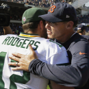 Chicago Bears head coach Marc Trestman greets Green Bay Packers quarterback Aaron Rodgers (12) after their NFL football game Sunday, Sept. 28, 2014, in Chicago. The Packers won 38-17. The Associated Press