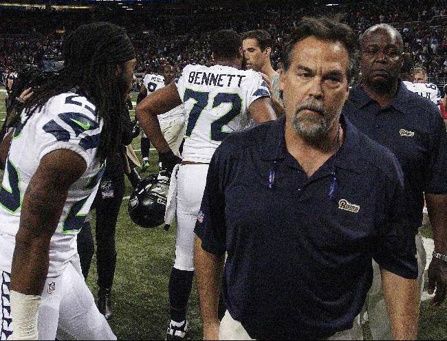 St. Louis Rams head coach Jeff Fisher leaves the field after an NFL football game against the Seattle Seahawks, Monday, Oct. 28, 2013, in St. Louis. The Seahawks won 14-9