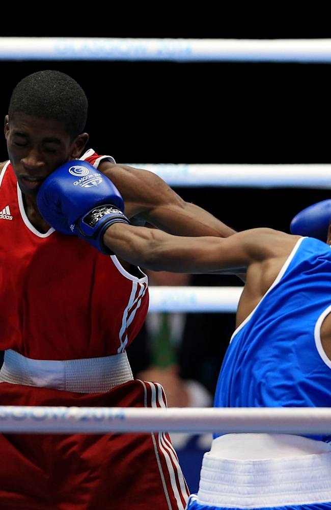 Barbados' Ricardo Blackman, left, in action against Botswana's Oteng Oteng in the Men's Fly (52kg) Round of 16 match at the SECC, during the 2014 Commonwealth Games in Glasgow, Scotland, Sunday, July 27, 2014