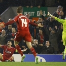 Liverpool's Steven Gerrard, left, unsuccessfully appeals for a penalty during the Champions League Group B soccer match between Liverpool and FC Basel at Anfield Stadium in Liverpool, England, Tuesday, Dec. 9, 2014