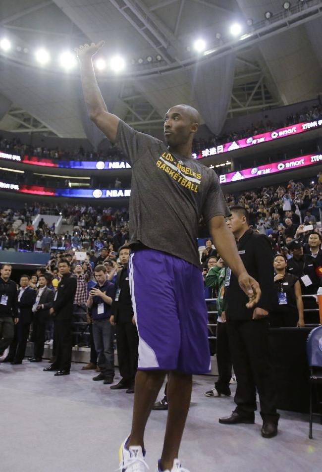 Kobe Bryant of Los Angeles Lakers waves to his fans during NBA Fan Appreciation Day event ahead of a 2013-2014 NBA preseason game against Golden State Warriors in  Shanghai, China, Thursday, Oct. 17, 2013. Lakers will compete against Warriors in two NBA preseason games respectively in Shanghai on Friday