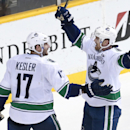 Vancouver Canucks center Ryan Kesler (17) celebrates with Henrik Sedin (33), of Sweden, after Kesler scored the second of his two goals in the third period of an NHL hockey game against the Nashville Predators Tuesday, Dec. 3, 2013, in Nashville, Tenn. Th