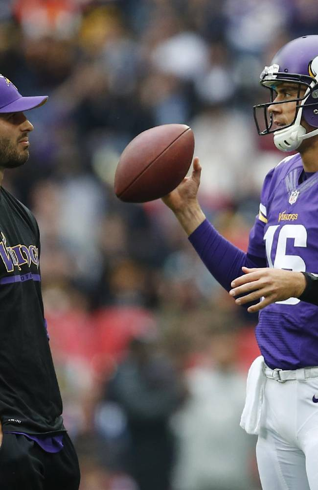 Injured Minnesota Vikings quarterback Christian Ponder, left, chats with quarterback Matt Cassel during warms up before their NFL football game against the Pittsburgh Steelers at Wembley Stadium, London, Sunday, Sept. 29, 2013