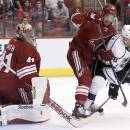 Los Angeles Kings' Maxim Kitsyn (48) has his shot poked away by Arizona Coyotes' Mike Smith, left, as Coyotes' Chris Summers (20) defends during the first period of a preseason NHL hockey game Monday, Sept. 22, 2014, in Glendale, Ariz. (AP Photo/Ross D. Franklin)