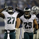 Philadelphia Eagles' Malcolm Jenkins (27) and Nate Allen (29) celebrate after stopping Dallas Cowboys' Joseph Randle on a running play during the second half of an NFL football game, Thursday, Nov. 27, 2014, in Arlington, Texas The Associated Press