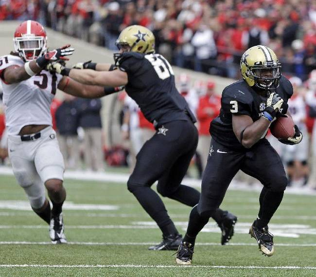Vanderbilt running back Jerron Seymour (3) scores the game-winning touchdown on a 13-yard run as Steven Scheu (81) blocks Georgia linebacker Ramik Wilson (51) in the fourth quarter of an NCAA college football game on Saturday, Oct. 19, 2013, in Nashville, Tenn. Vanderbilt upset No. 15 Georgia 31-27