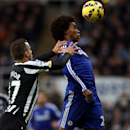 Newcastle United's Steven Taylor, left, vies for the ball with Chelsea's Willian, right, during their English Premier League soccer match at St James' Park, Newcastle, England, Saturday, Dec. 6, 2014