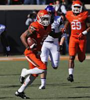 Oklahoma State's Josh Stewart (5) returns a punt for a touchdown against TCU in the first quarter of an NCAA college football game in Stillwater, Okla., Saturday, Oct. 19, 2013. (AP Photo/Sue Ogrocki)