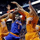 New York Knicks' Amare Stoudemire (1) has his shot blocked by Phoenix Suns' Markieff Morris, left, as Channing Frye (8) defends during the first half of an NBA basketball game, Friday, March 28, 2014, in Phoenix The Associated Press