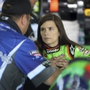 Danica Patrick, right, talks with crew chief Tony Eury Jr. before practice for the NASCAR Sprint Showdown auto race at Charlotte Motor Speedway in Concord, N.C., Friday, May 17, 2013. (AP Photo/Bob Jordan)