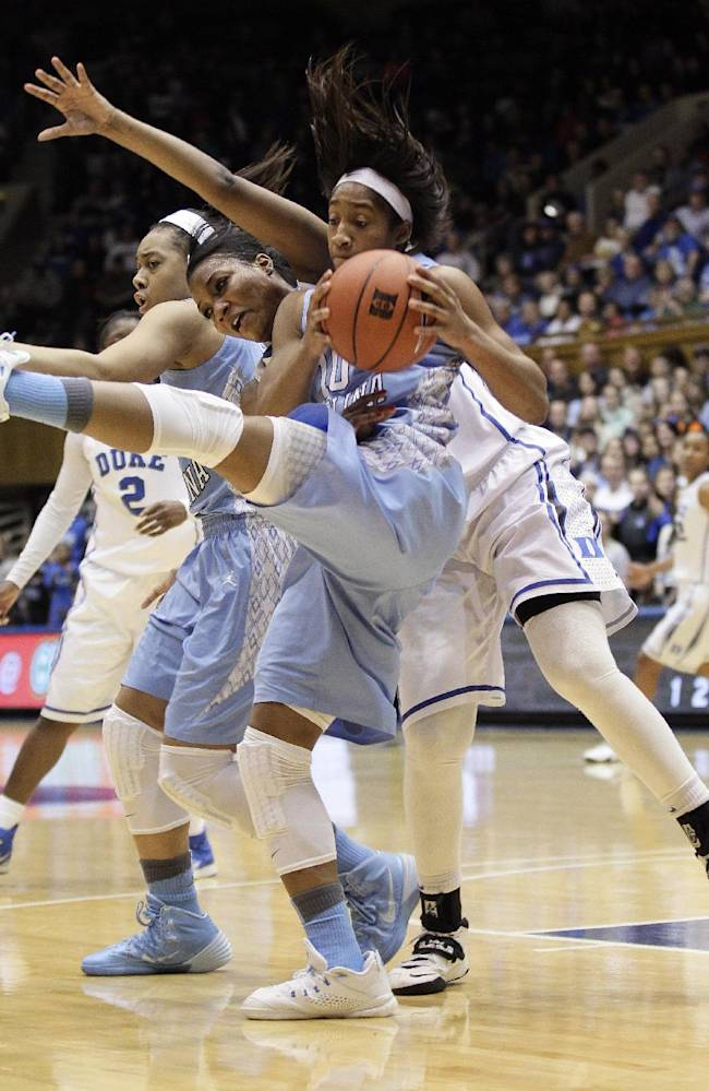 North Carolina's Danielle Butts, front, and Allisha Gray struggle for possession of the ball with Duke's Richa Jackson, center, during the second half of an NCAA college basketball game in Durham, N.C., Monday, Feb. 10, 2014. North Carolina won 89-78