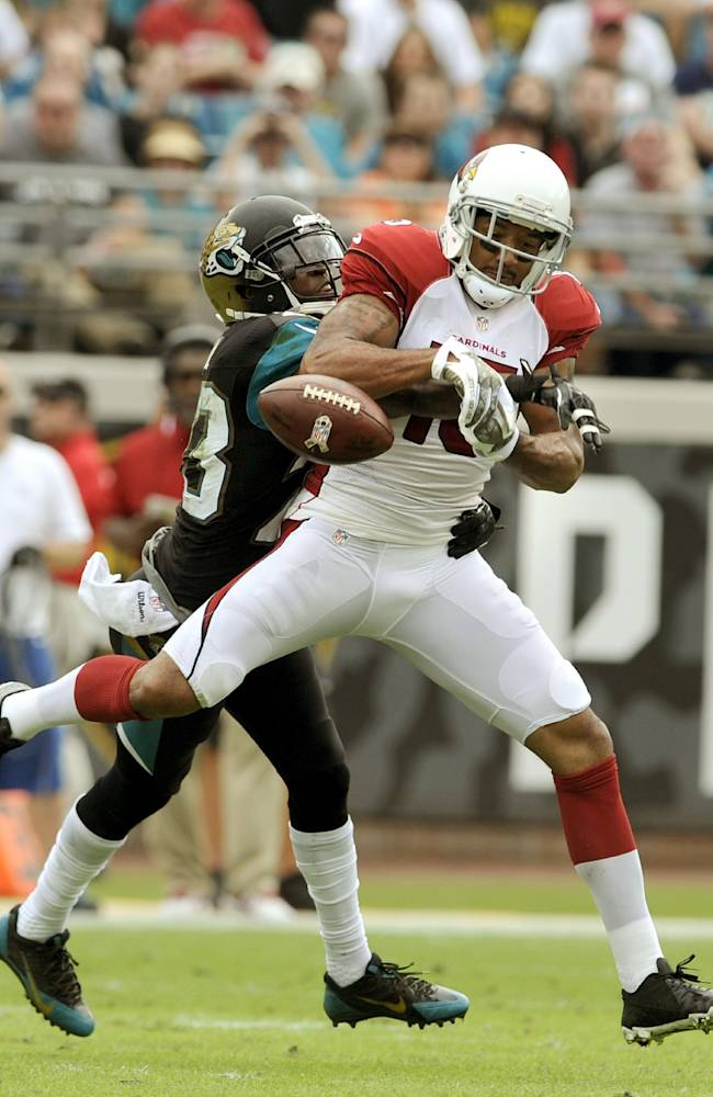 Jacksonville Jaguars cornerback Alan Ball (23) breaks up a pass to Arizona Cardinals wide receiver Michael Floyd (15) during the first half of an NFL football game, Sunday, Nov. 17, 2013, in Jacksonville, Fla