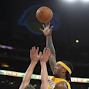 Los Angeles Lakers center Jordan Hill, right, puts up a shot as Golden State Warriors forward David Lee defends during the first half of an NBA basketball game, Friday, Nov. 22, 2013, in Los Angeles The Associated Press
