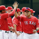 Texas Rangers catcher Robinson Chirinos, left, and Shin-Soo Choo greet before an opening day baseball game against the Philadelphia Phillies at Globe Life Park, Monday, March 31, 2014, in Arlington, Texas The Associated Press