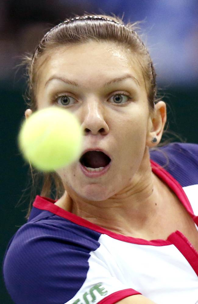 Romania's Simona Halep returns a shot to Australia's Samantha Stosur during their final match at the Kremlin Cup tennis tournament in Moscow, Russia, Sunday, Oct. 20, 2013