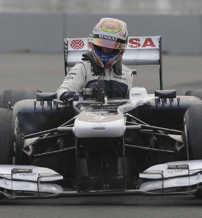 Williams driver Pastor Maldonado of Venezuela gets from his car after he stopped during the second practice session at the Indian Formula One Grand Prix at the Buddh International Circuit in Noida, India, Friday, Oct. 25, 2013