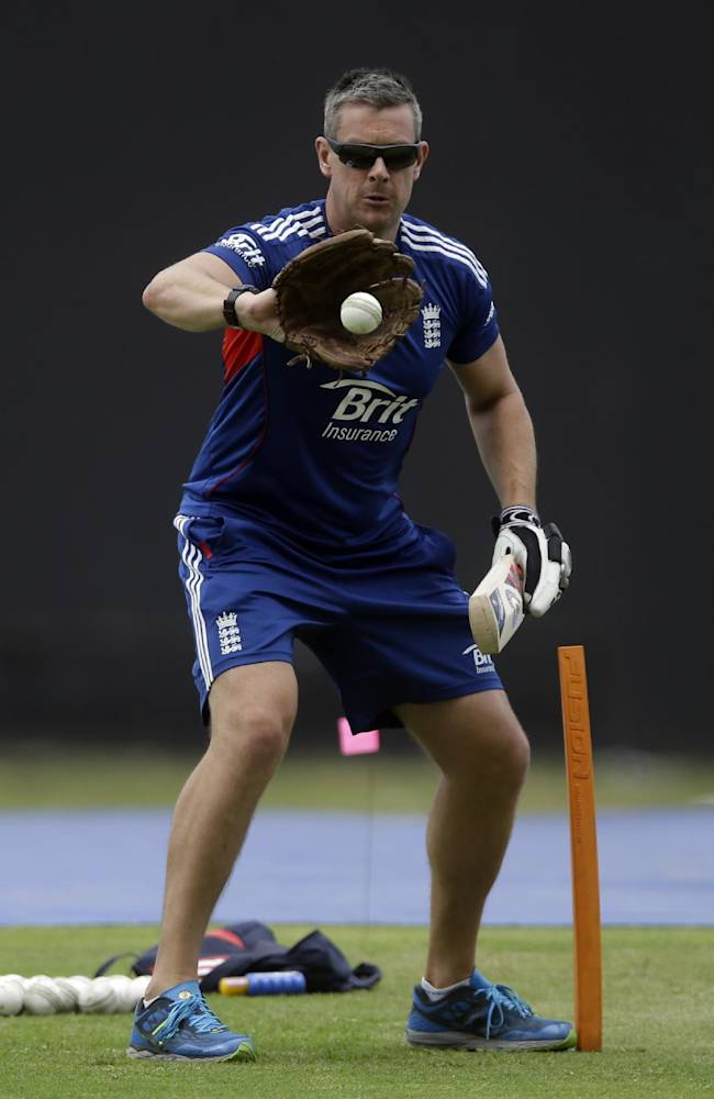 England's cricket coach Ashley Giles catches a ball with a glove during a practice at the Sir Vivian Richards Cricket Ground in St. John's, Antigua, Thursday, Feb. 27, 2014. England will face West Indies on three one-day internationals in Antigua and three Twenty20 matches in Barbados during their tour