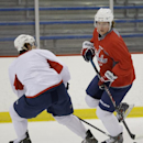 Washington Capitals center Nicklas Backstrom, right, skates with the puck during a Capitals hockey practice, Tuesday, Feb. 25, 2014, in Arlington, Va The Associated Press