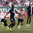 Belize's Tyrone Pandy (23) looks to clear the ball out of the goal mouth after Belize goalie Shane Orio, second from left, blocks a shot during the first half of their CONCACAF Gold Cup soccer game against the United States in Portland, Ore., Tuesday, July 9, 2013.(AP Photo/Don Ryan)