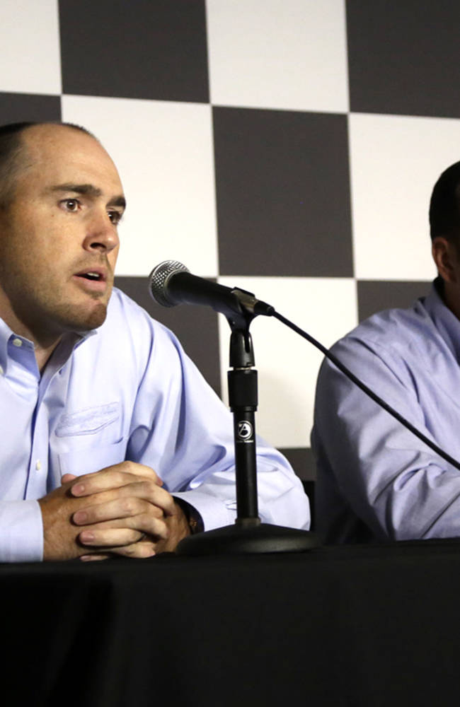 Stewart-Haas Racing executive vice president Brett Frood, left, speaks during a news conference as crew chief Greg Zipadelli looks on at right at Michigan International Speedway in Brooklyn, Mich., Friday, Aug. 15, 2014. Tony Stewart will not race Sunday at Michigan International Speedway, skipping a second straight NASCAR Sprint Cup race since striking and killing a driver in a dirt-track race at a small New York track. Jeff Burton will drive Stewart's No. 14 Chevrolet in Michigan. (AP Photo/The Jackson Citizen Patriot, Brian Smith) ALL LOCAL TELEVISION OUT; ALL LOCAL INTERNET OUT
