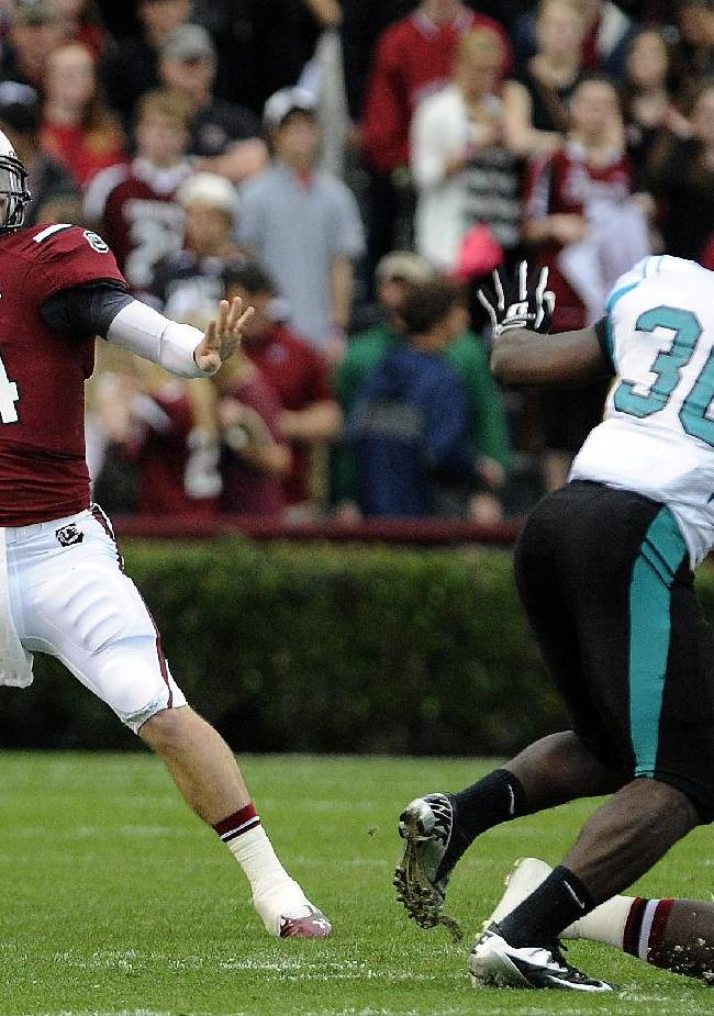 South Carolina quarterback Connor Shaw (14) passes down field during the first half of an NCAA college football game against Coastal Carolina, Saturday, Nov. 23, 2013 in Columbia, S.C