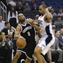 Brooklyn Nets' Alan Anderson (6) draws a foul from Orlando Magic's Arron Afflalo (4) as he tries to drive around him during the first half of an NBA basketball game in Orlando, Fla., Wednesday, April 9, 2014 The Associated Press