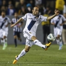 FILE - In this April 3, 2013 file photo, Los Angeles Galaxy midfielder Landon Donovan controls the ball during the second half of the CONCACAF Champions League semifinal against Monterrey in Carson, Calif. Donovan is returning to the U.S. national team after an absence of nearly 11 months. (AP Photo/Bret Hartman, File)