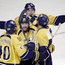 Nashville Predators left wing James Neal (18) celebrates with Anton Volchenkov (20), of Russia; Filip Forsberg (9), of Sweden; and Seth Jones (3) after Neal scored a goal against the Winnipeg Jets in the second period of an NHL hockey game Saturday, Nov.