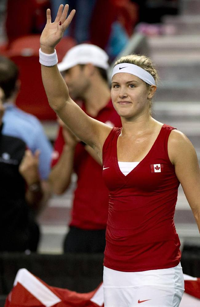 Eugenie Bouchard, of Canada, celebrates her win over Kristina Kucova, of Slovakia, during the second match at the Fed Cup tennis tournament, Saturday, April 19, 2014, at Laval University in Quebec City. Bouchard won 7-6, 2-6, 6-1