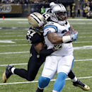 Carolina Panthers fullback Mike Tolbert (35) carries as he is tackled by New Orleans Saints outside linebacker David Hawthorne (57) in the first half of an NFL football game in New Orleans, Sunday, Dec. 8, 2013 The Associated Press