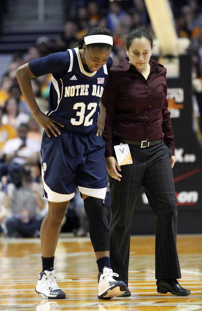 Notre Dame guard Jewell Loyd (32) walks off the court after being injured in the second half of an NCAA college basketball game against Tennessee Monday, Jan. 20, 2014, in Knoxville, Tenn. Notre Dame won 86-70
