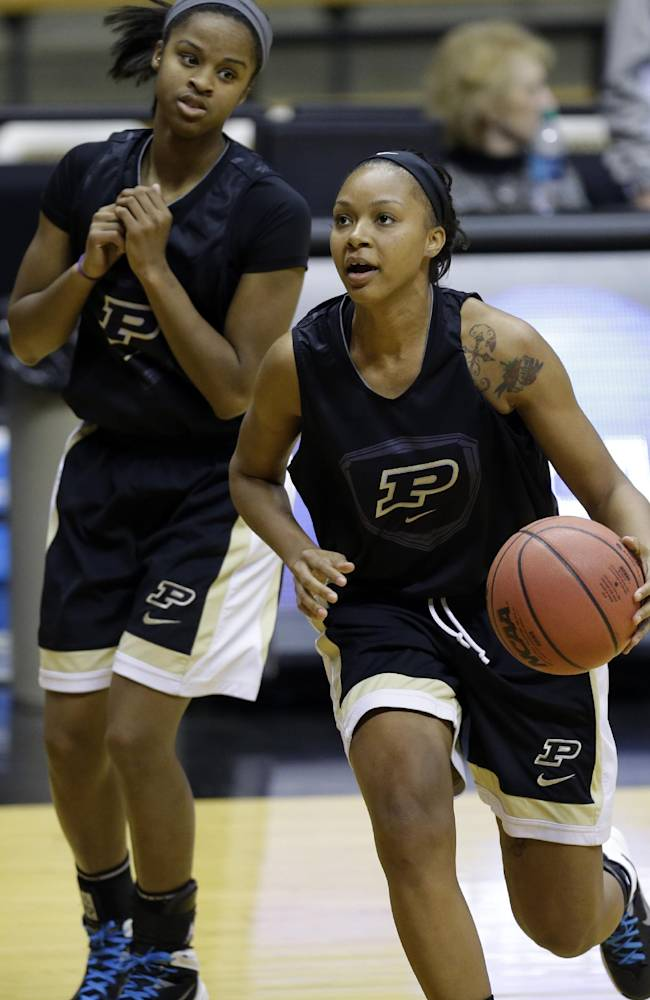 Purdue guard Dee Dee Williams, right, drives in front of teammate April Wilson during practice at the NCAA women's college basketball tournament in West Lafayette, Ind., Friday, March 21, 2014.  Purdue plays Akron in a first-round game on Saturday